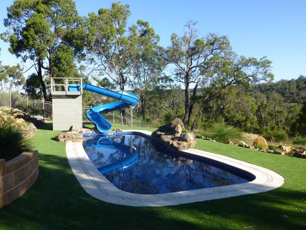 Domestic water slides australian waterslides leisure for Pool design with slide